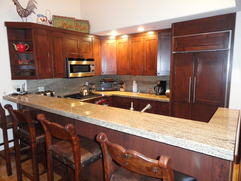 Kitchen with Subzero fridge and Wolf stove Slide-5