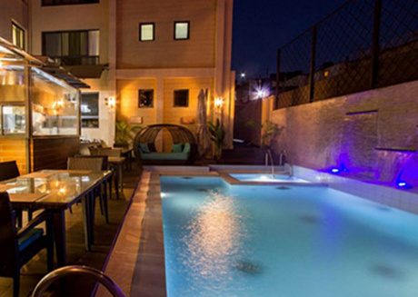 Stay at the Landmark Suites and relax by the pool and enjoy the amenities