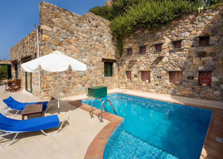Villa Artemis is on the peak of a hillside overlooking the Mediterranean sea.