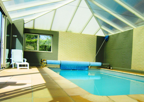 Cottage with swimming pool comprises two separate parts