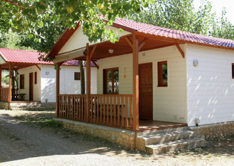 Wooden bungalow located on a small holiday park with a swimming pool in a beautiful environment.