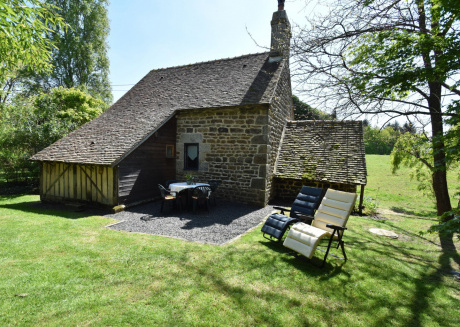 Restored bakehouse on a traditional farmstead.