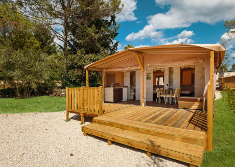 Luxury glamping tent with bathroom/kitchen, located in a park with swimming pool