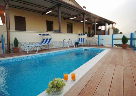Comfortable villa with veranda and outdoor kitchen at the private pool